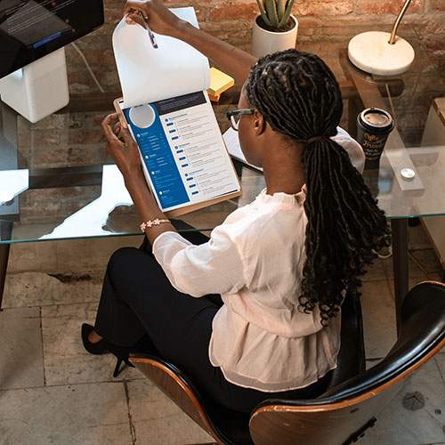 Woman reviewing data contractor resumes